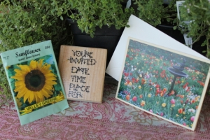 Here is a photo I took that I put on the front of a blank card. 'Your Invited' rubber stamp and pack of seeds!
